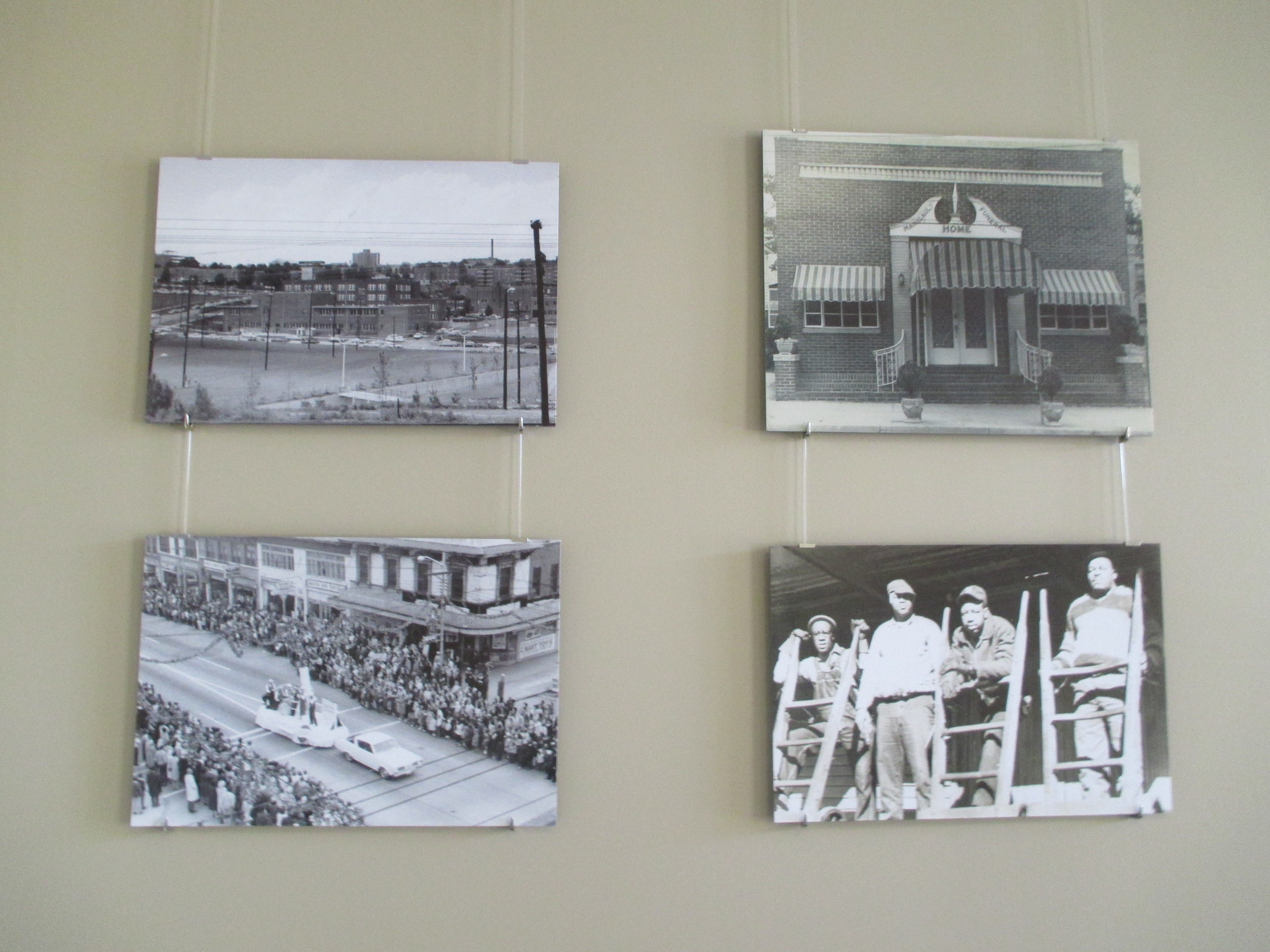Four photos held by Koslov's hanging system in the People section of the exhibit.