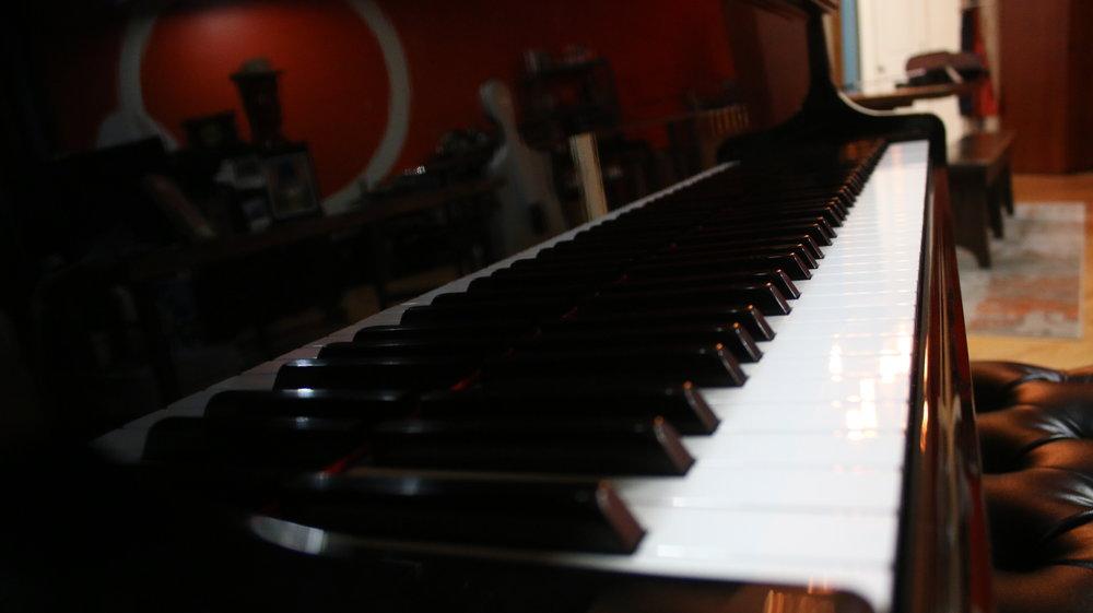 Regularly maintained baby grand Yamaha piano