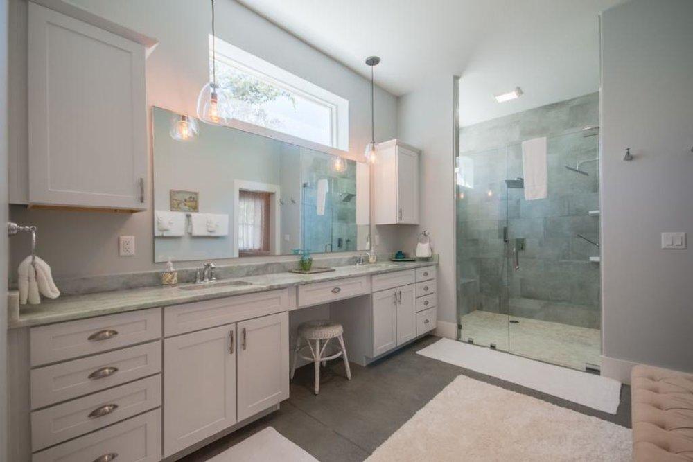 king_bedroom_private_bath_large_shower.jpeg