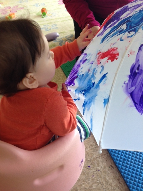 One of our Little ones exploring Reggio inspired art on an umbrella. Exploring art truly benefits each person, no matter how big or small.