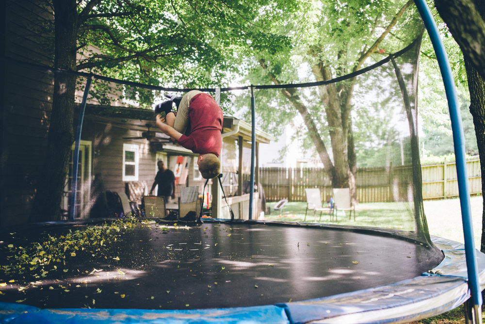family-photographer-roanoke-boy-doing-back-flip