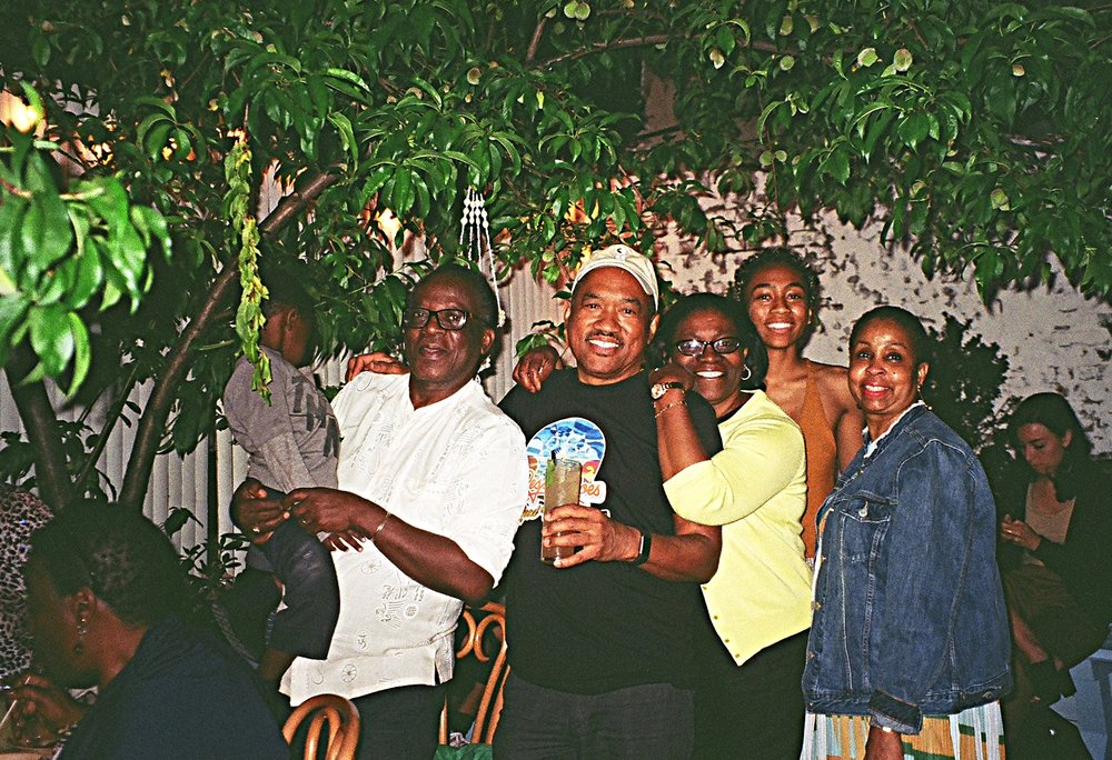 """At a Kit an' Kin Family Feast (from left): Anya Peter's """"baby"""" cousin RJ Richmond, uncle Eric Richmond, dad Neil Peters, aunt Yvette Richmond, Anya, and mom Andrea Peters. [all photos courtesy of Alana Yolande]"""