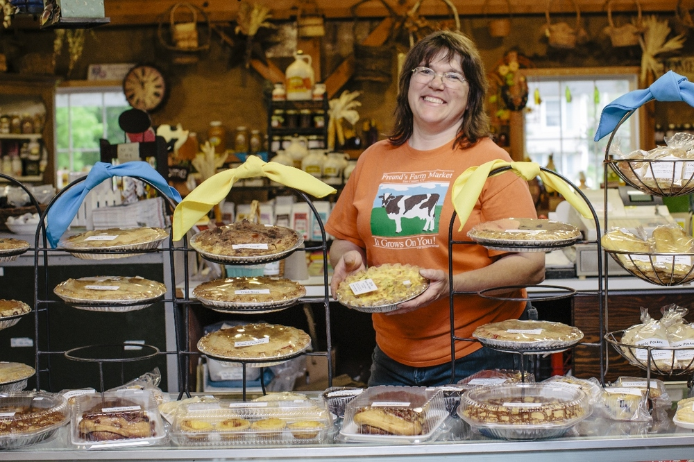 photo credit: Cabot Creamery Theresa Freund shows off the flavors of the day with her freshly baked pies.