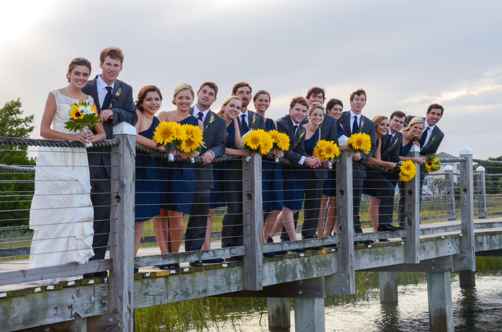 Bride, groom and bridal party on dock at the Marina at Edisto Beach.