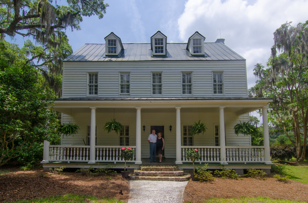 Ralph and Brenda Morris in front of their home, the Bailey Plantation House.