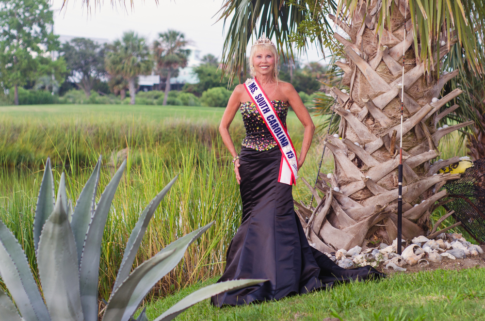 Becky Rose, Ms. Senior South Carolina, 2015 poses by the marsh grass and palmetto tree.