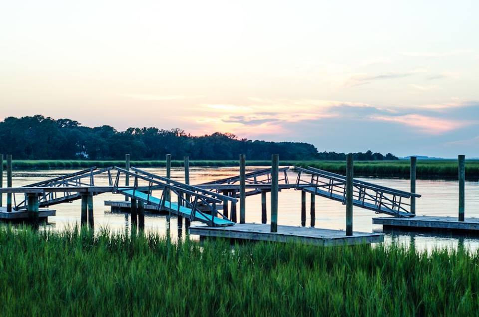 View of docks and marsh at sunset.