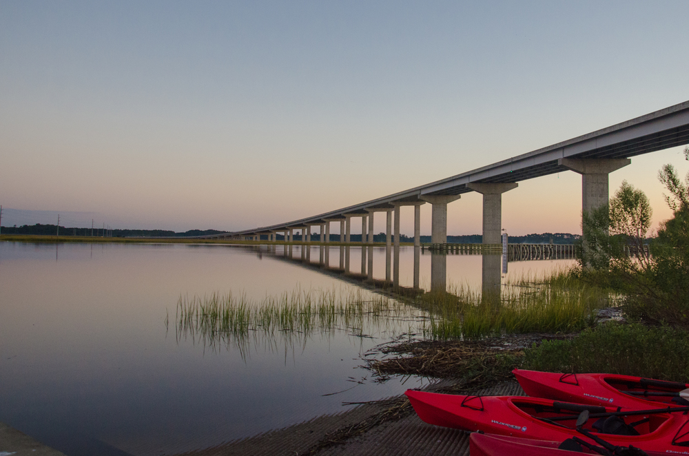 View kayaks ready to launch next to the McKinley Washington Jr. Bridge to Edisto Island, SC.