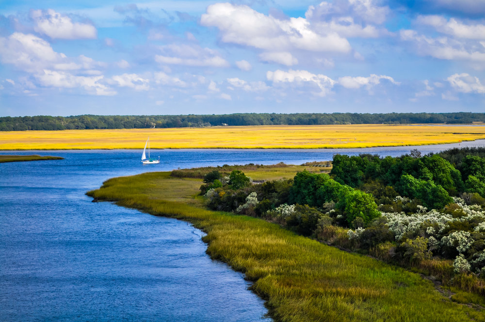 Colorful view of sailboat in creek at Edisto Island, SC.