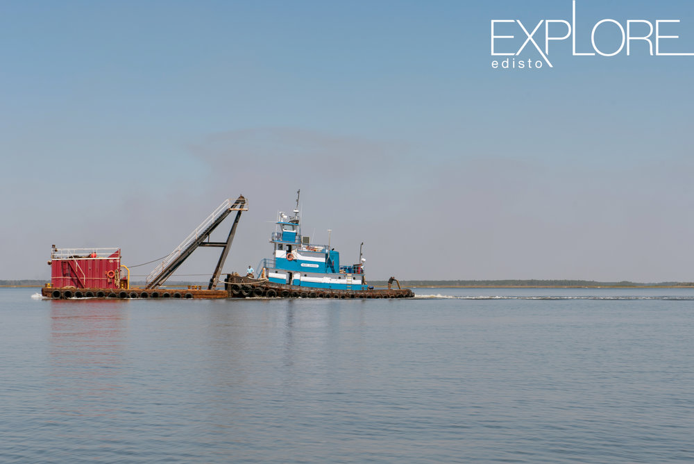 Barge and freight moving in the water.