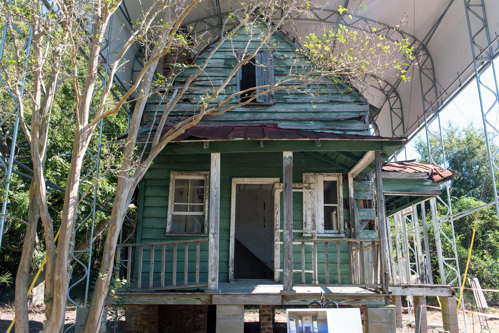 Old green house, the Hutchinson House, under tent to be restored