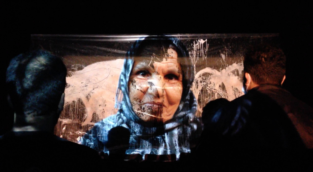 Eid Fatima (Fatima's hand) Live Projection Painting Performance piece @ cinealt, Marakech, Morocco, 8mins. November 2013. Thre3 Strokes were again invited to take part in another international based arts program. This time alongside 'Mint Collective'; an international residency program based in Marrakech, Morocco. We continued our 'live projection painting' experiences, this time based around the highly superstitious Moroccan culture and history surrounding religion, black magic and superstition. The pre recorded film coming to life, again through live painting through hands and performance arts. This time we aded another element, that of live music- A flute player. Thre3 Strokes were there for just over a week and created an 'immersive' cinematic experience with Mint Collective, merging together live projection painting, live music and live performance all under one roof. Together, we called it 'CineAlt'. At the time, the 5th Marrakech Biennial was running as well as the Marrakech International Film Festival and so we wanted to create an event that could hold it's worth and be true to it's core; which is the arts. We found the oldest cinema in town, right amongst the souks, and to our surprised was untouched for over 40years. Dust filled the space, homeless cats took up most it's corners. This space was incredible and completely enriching to the piece & the immersive experience. We invited members of the general public to come and experience what we had to offer, free of charge, in hope to engage more with the wider community within Marrakech. Queues gathered at the entrance to the cinema. Guests being lead down to their seats via guiding flash lights and the sound of a flute. It was pitch black in there. Then when the audience settled, it was time.. Projector came on, the performance began.. The response was incredible, the people never having seen anything like it before.