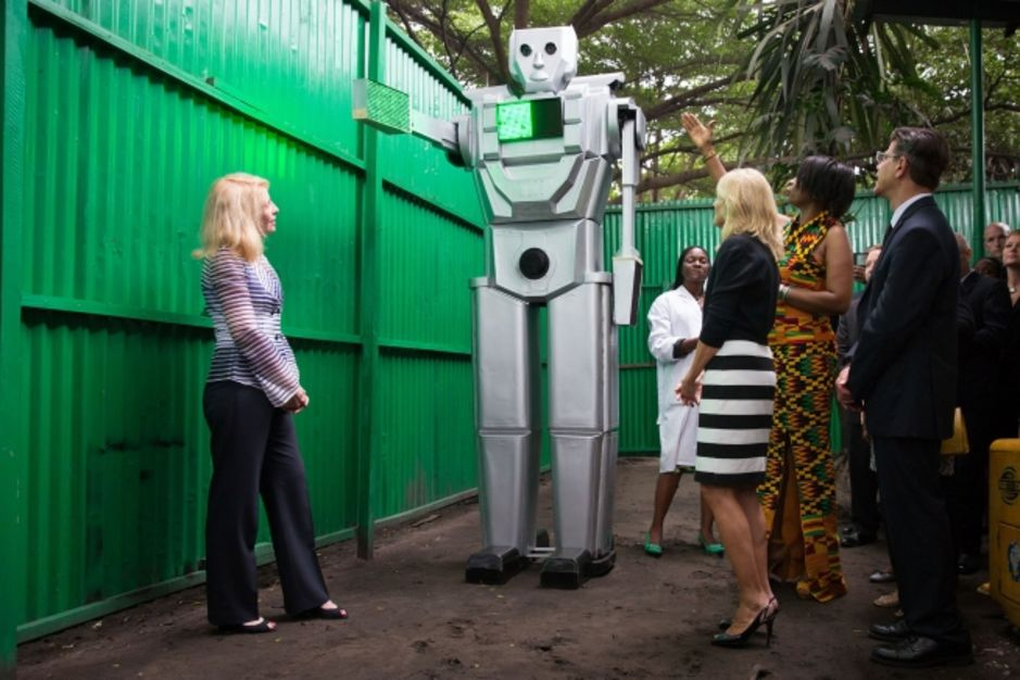 Dr. Jill Biden and Cathy Russell, U.S. Ambassador-at-Large for Global Women's Issues, are briefed by Therese Izay Kirongozi, during a tour of the Kinshasa Traffic Robot Lab, in Kinshasa, Democratic Republic of Congo, July 4, 2014. Robots are being developed to aid pedestrians in crossing congested streets (Official White House Photo by David Lienemann)