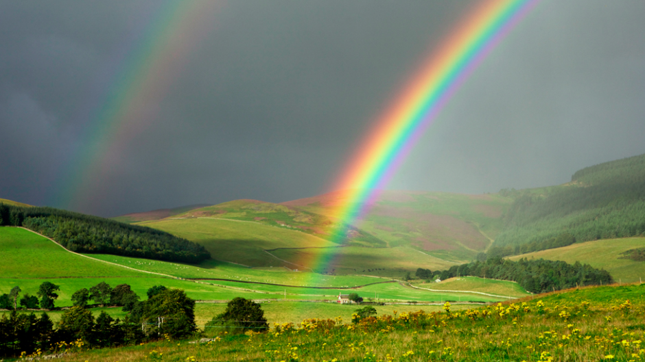 The same rainbow and landscape as seen by a colorblind person using EnChroma's glasses. (Photo courtesy of EnChroma)