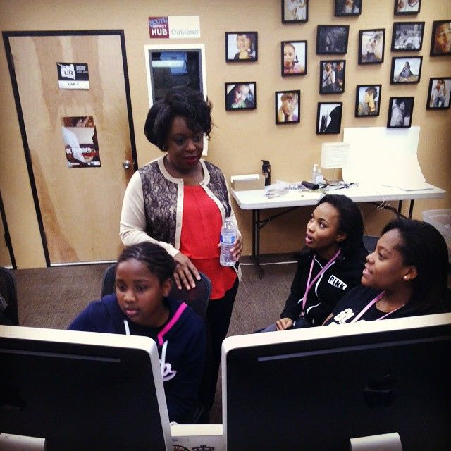Kimberly Bryant, standing, the founder of Black Girls Code. (Photo courtesy of the Black Girls Code Facebook page)