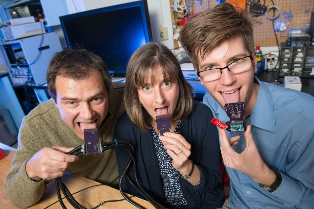 Dr. John Williams, left, a professor of mechanical engineering, Dr. Leslie Stone-Roy, a professor of neuroscience, and JJ Moritz, a graduate student, are developing a device to hear with your tongue. (Photo courtesy of Colorado State University)