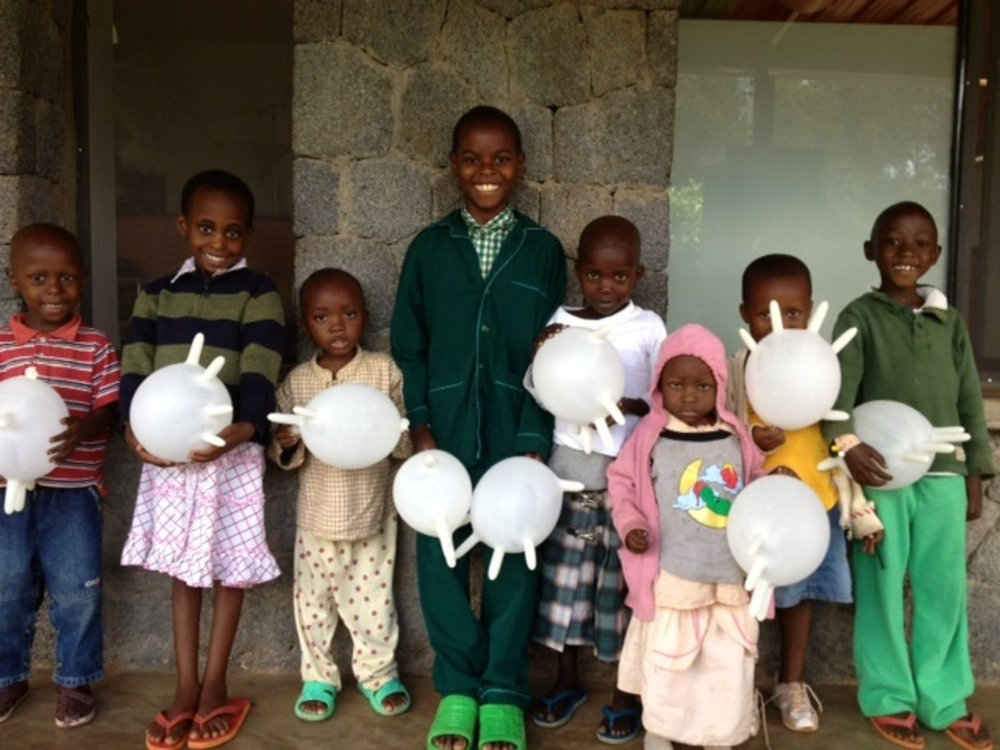 Children from the cancer ward with exam glove balloons. (Photo courtesy of Dr. Larry Shulman)