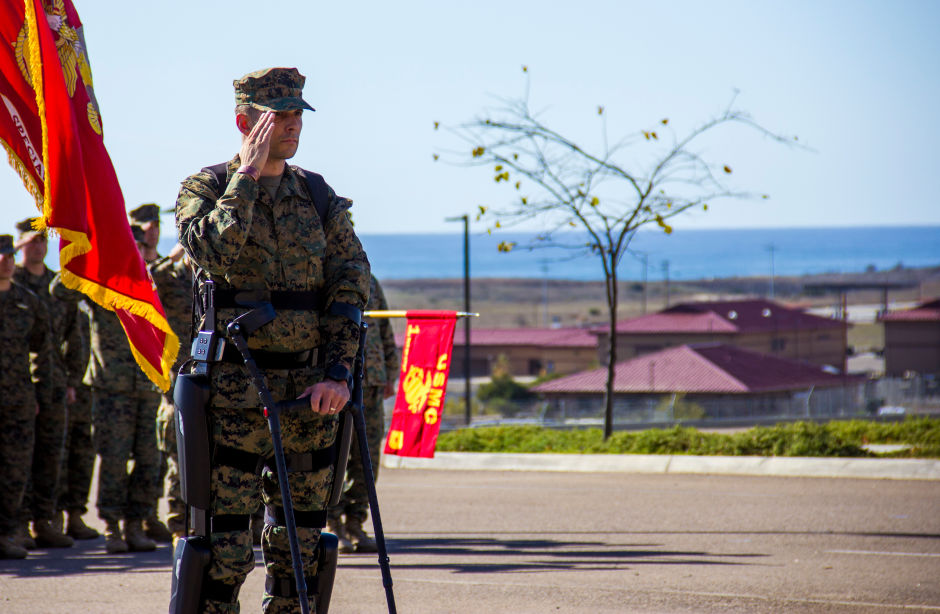 Capt. Derek Herrera, a special operations officer with 1st Marine Special Operations Battalion, renders a salute as the national anthem is played during a retirement ceremony aboard Camp Pendleton, Calif., on Nov. 21, 2014. (Photo credit: U.S. Marines)
