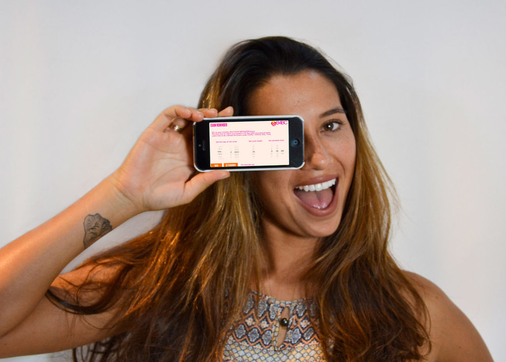 Pro surfer Malia Manuel with B4BC's app. (Photo courtesy of B4BC)