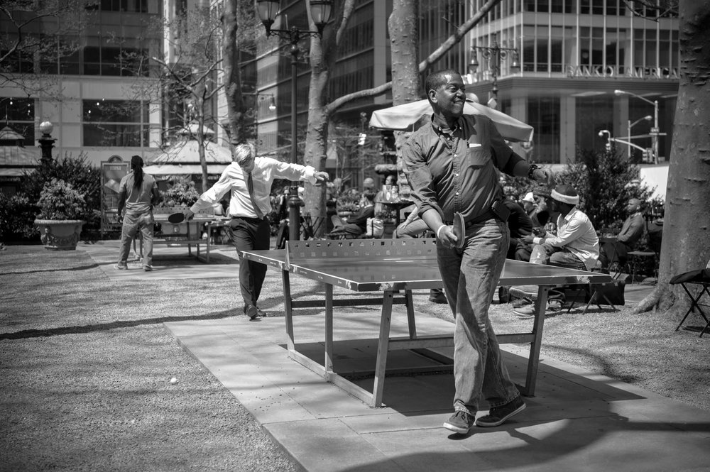 Men playing ping-pong in park, Bryant Park, street photography i
