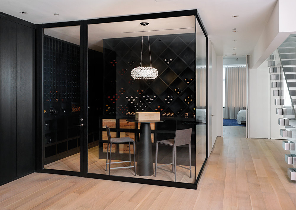Blackened steel framed wine room.