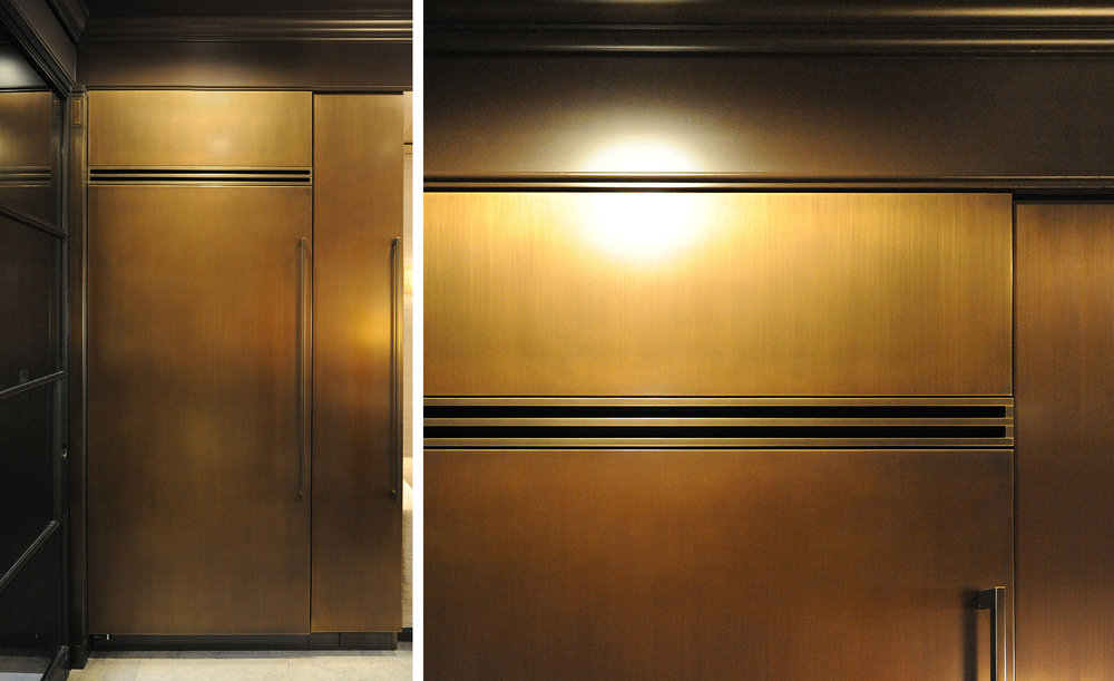 Sub-Zero appliances, stainless doors stripped to raw metal and patinated in special tinted bronze. Custom handles, returns and registers fabricated to match.
