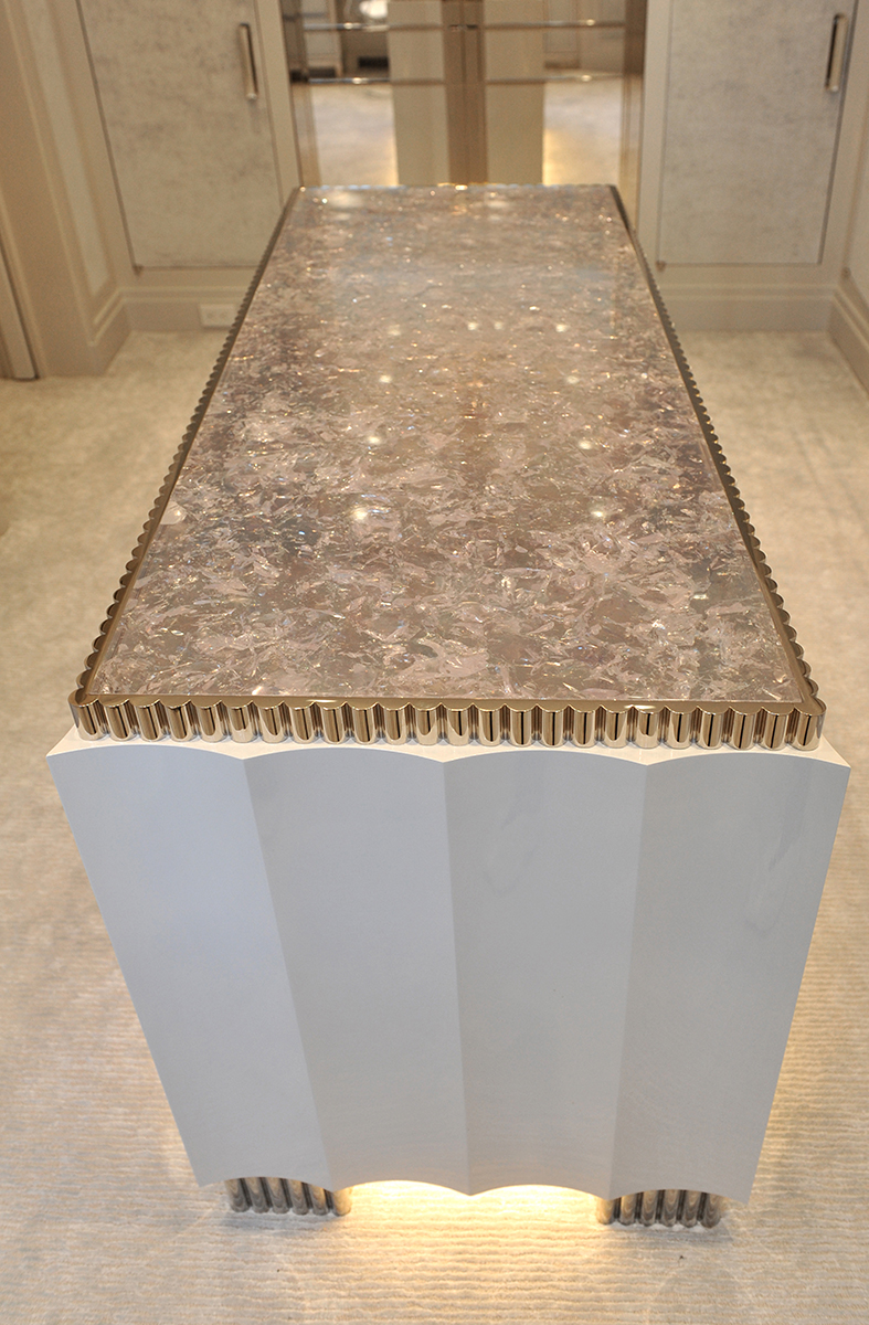 Infill of decorative resin surrounded by hand-crafted nickel edge