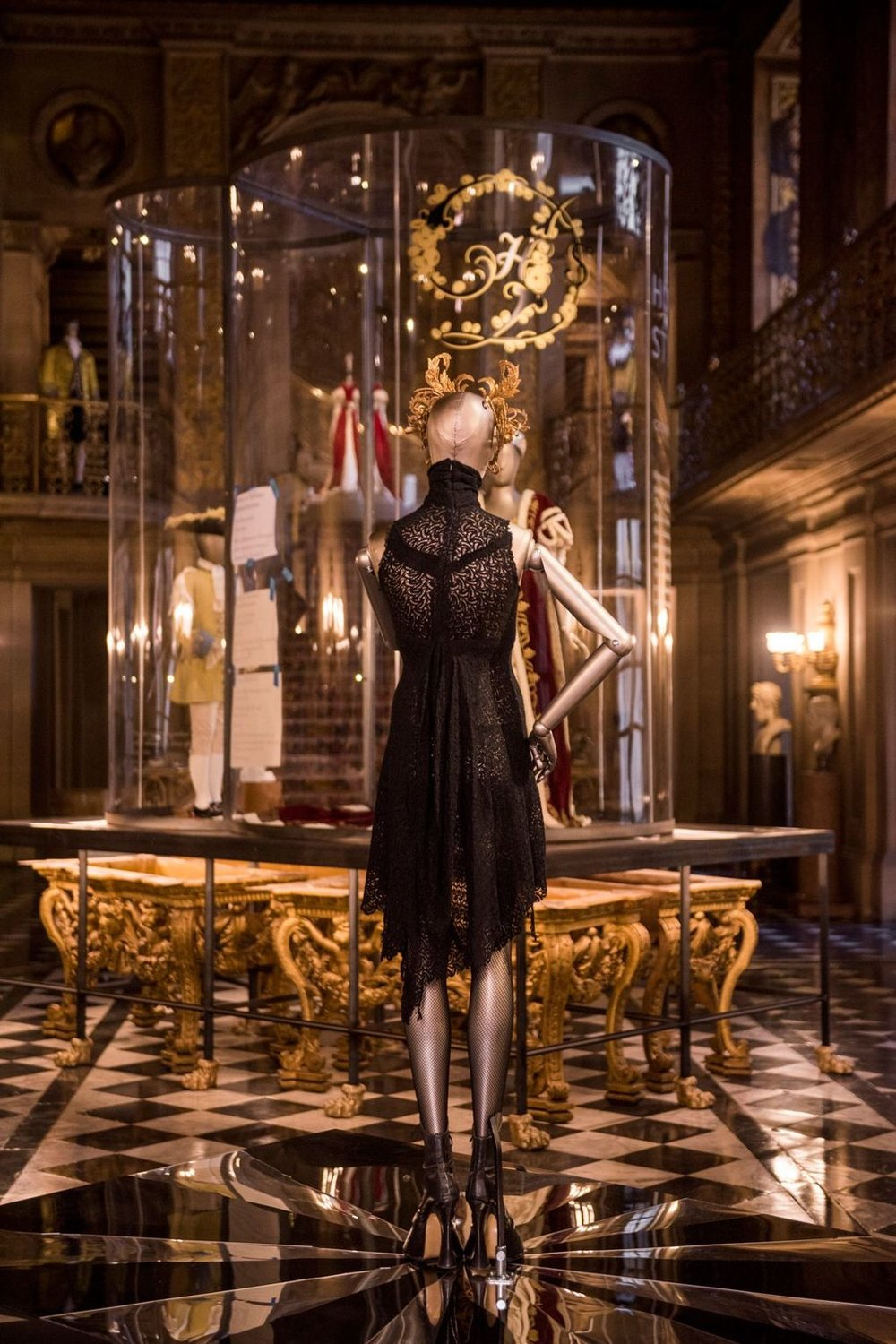 An Alexander McQueen dress worn by Stella Tennant in British Vogue is displayed in The Painted Hall at Chatsworth House. Image courtesy of Chatsworth Trust.