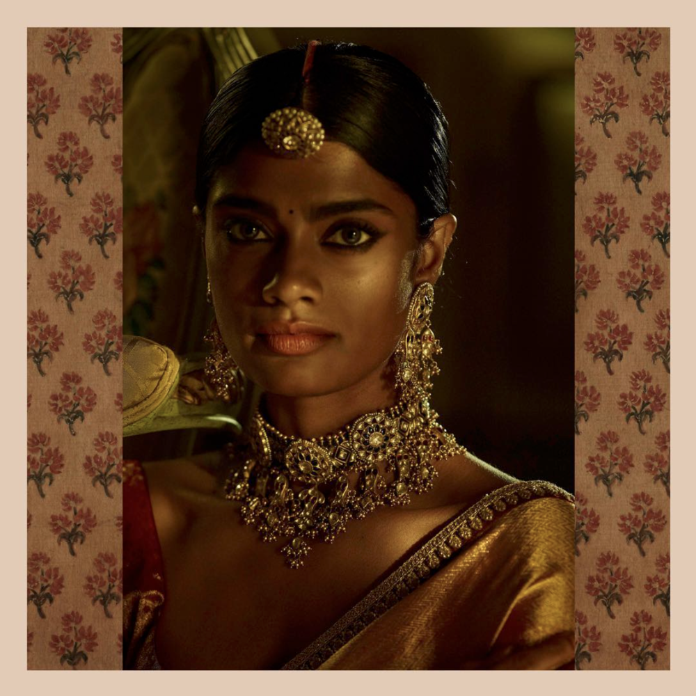 From Sabyasachi Mukherjee's  Instagram : The Golden Goddess. Gold kanjeevaram sari with uncut diamond and pearl studded heritage gold jewellery by Sabyasachi.
