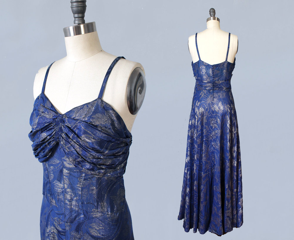 Blue lamé 1930s gown. Courtesy  Guermantes Vintage .