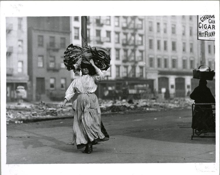 Carrying piece work for the garment industry .  The Miriam and Ira D. Wallach Division of Art, Prints and Photographs: Photography Collection, The New York Public Library. (1900 - 1937).