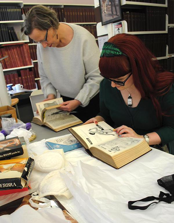 Lorraine Smith and Jane Holt in the London College of Fashion Archives. Photo by Madeleine Corcoran.