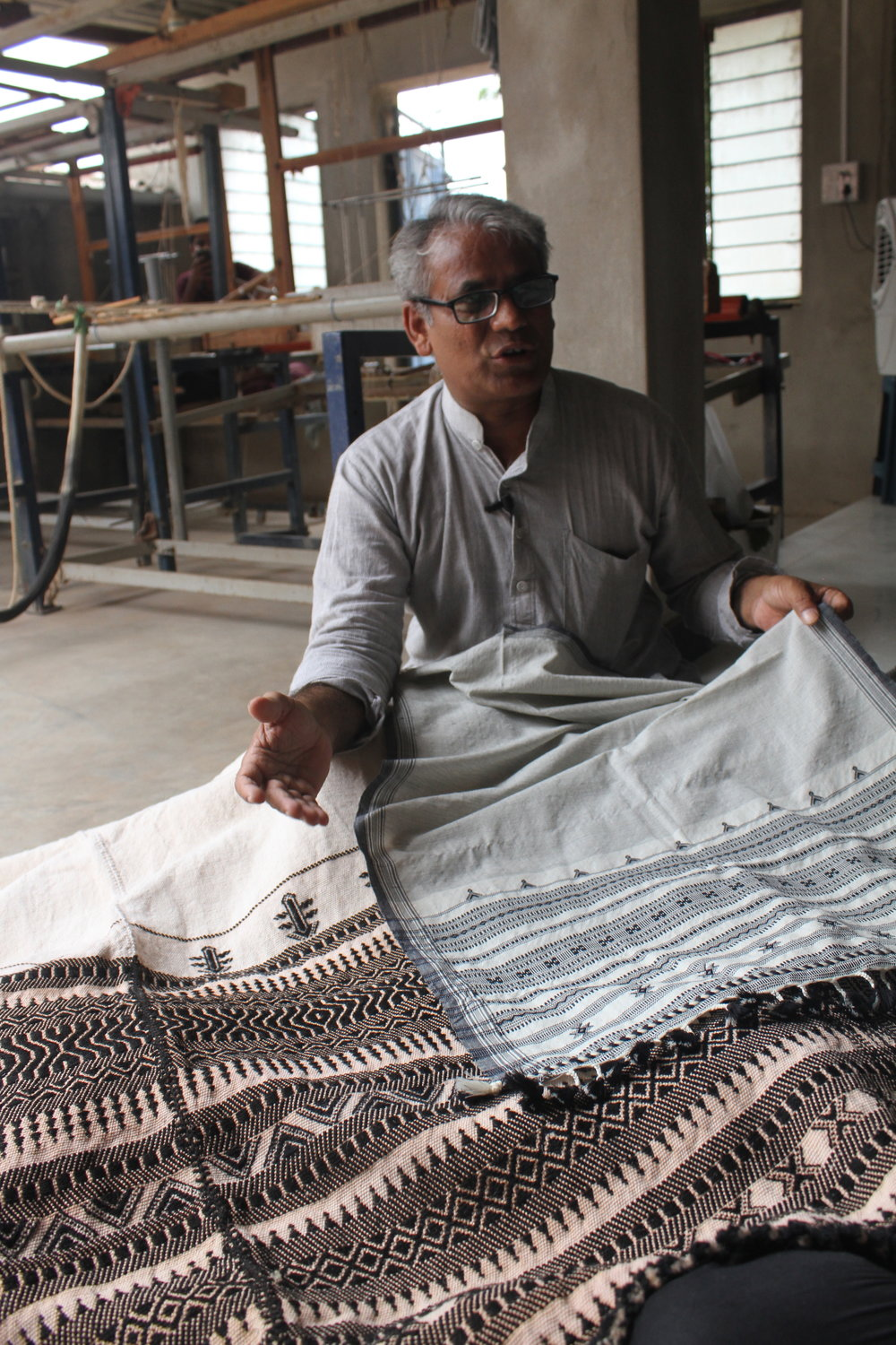 Dayalal Kudecha, a weaver from Bhujodi who attended KRV in 2008, after which he worked his way up from job-weaver to weaver-designer, entrepreneur and teacher. His products have a distinct look. He has perfected the use of natural dyes to achieve stunning color palettes, using a range of materials including different types of silk, and adapting traditional motifs and patterns to create high-quality designs.  Photo: Ruth Clifford