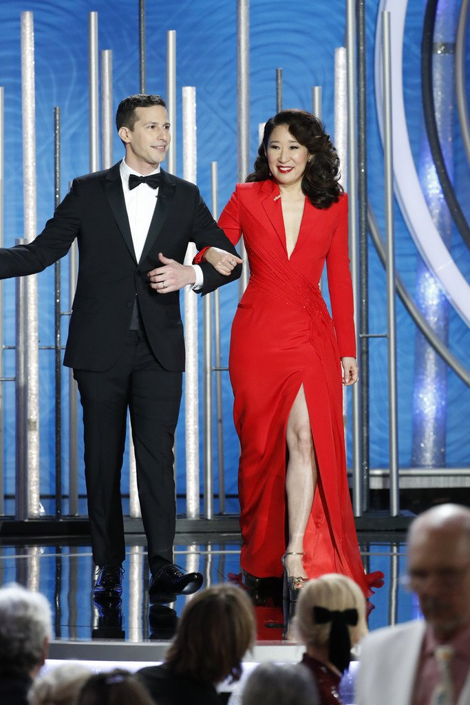 Golden Globes hosts Andy Samberg and Sandra Oh in Atelier Versace