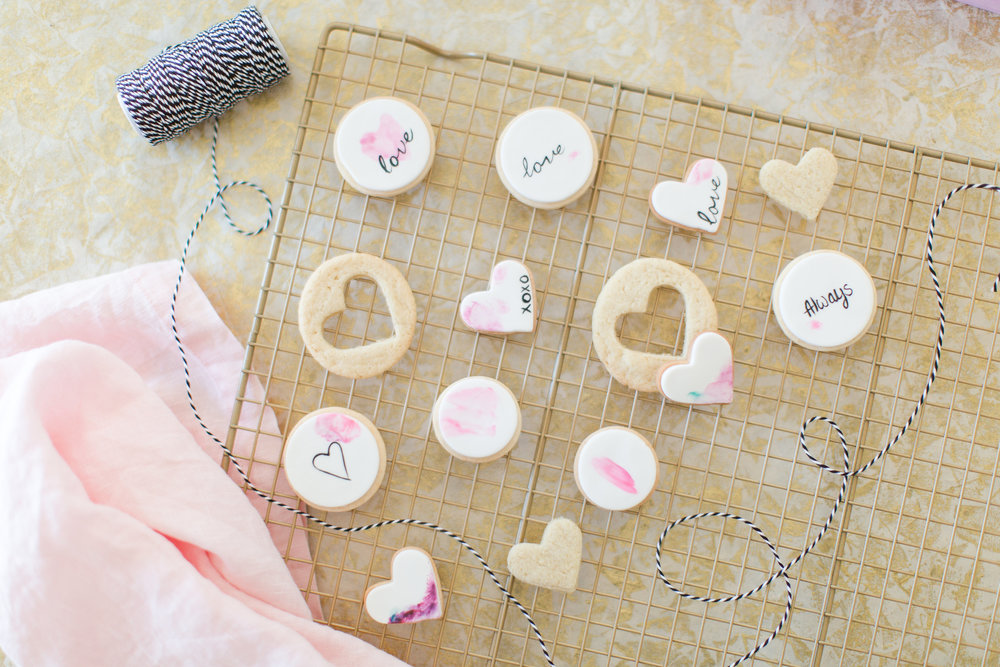 Watercolor sugar cookies with light touches of color.  The styling in this shot keeps everything soft.