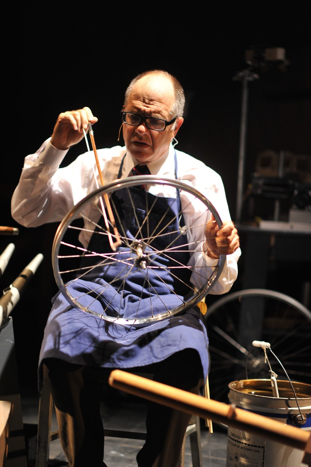 Pictured: Steven Schick bowing a bicycle wheel in the Paul Dresher Ensemble production of Schick Machine. Photo by Chi Wang.