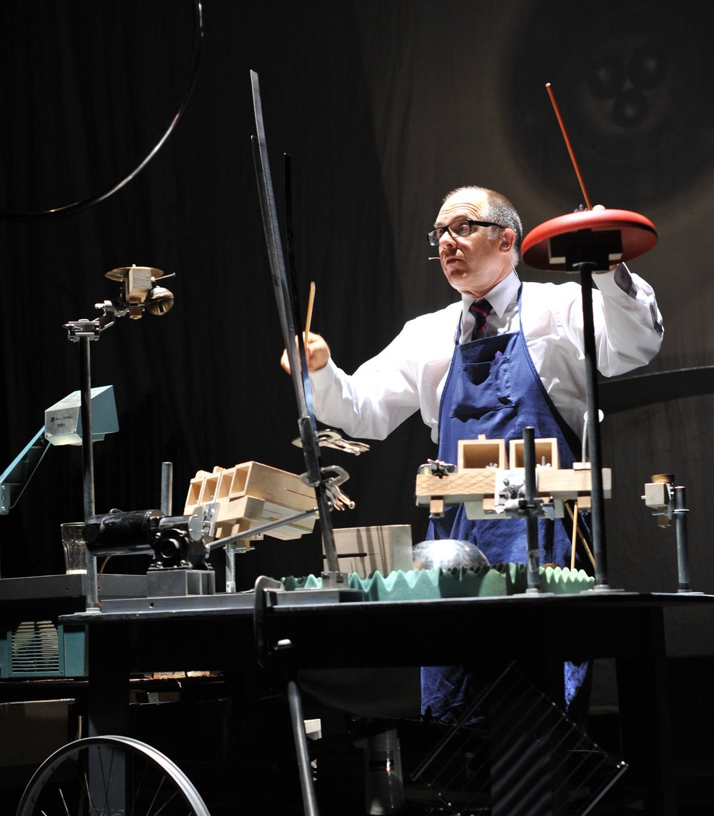 Pictured: Steven Schick at the Percussion Table in the Paul Dresher Ensemble production of Schick Machine. Photo by Chi Wang.