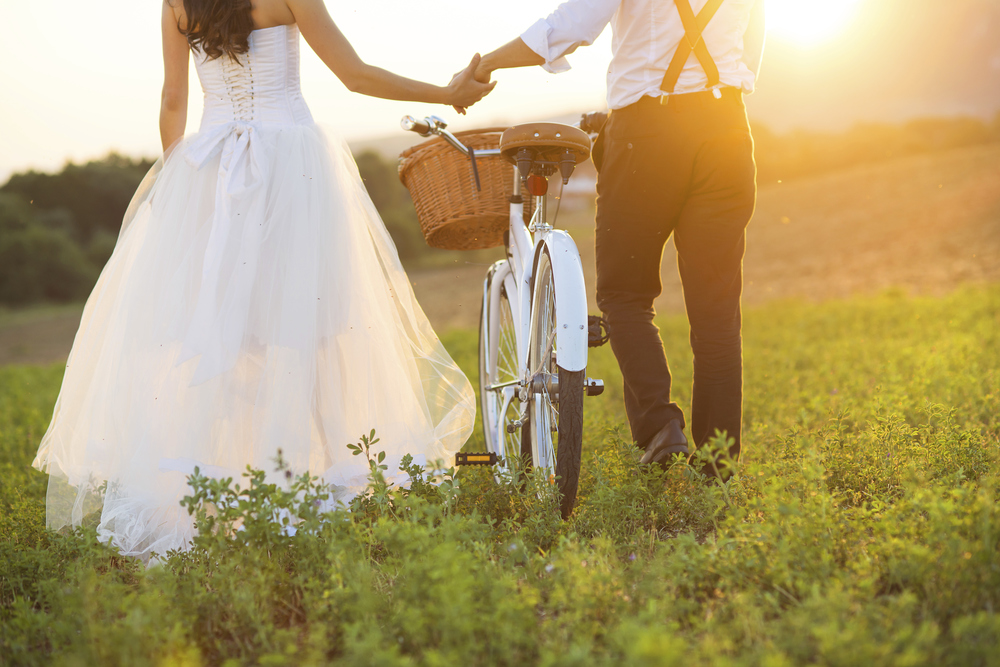 Bride and groom with a white wedding bike.jpg