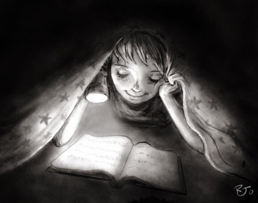 """Reading under my covers at night with my flashlight."""