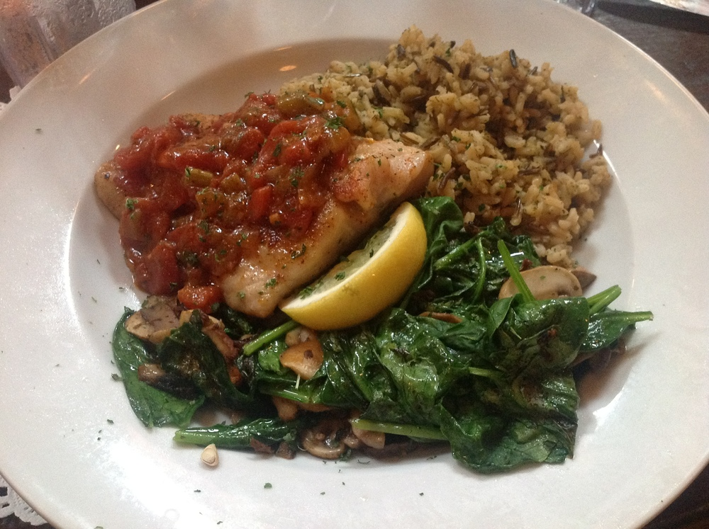 My huge dish: red snapper, wild rice, sauteed spinach.