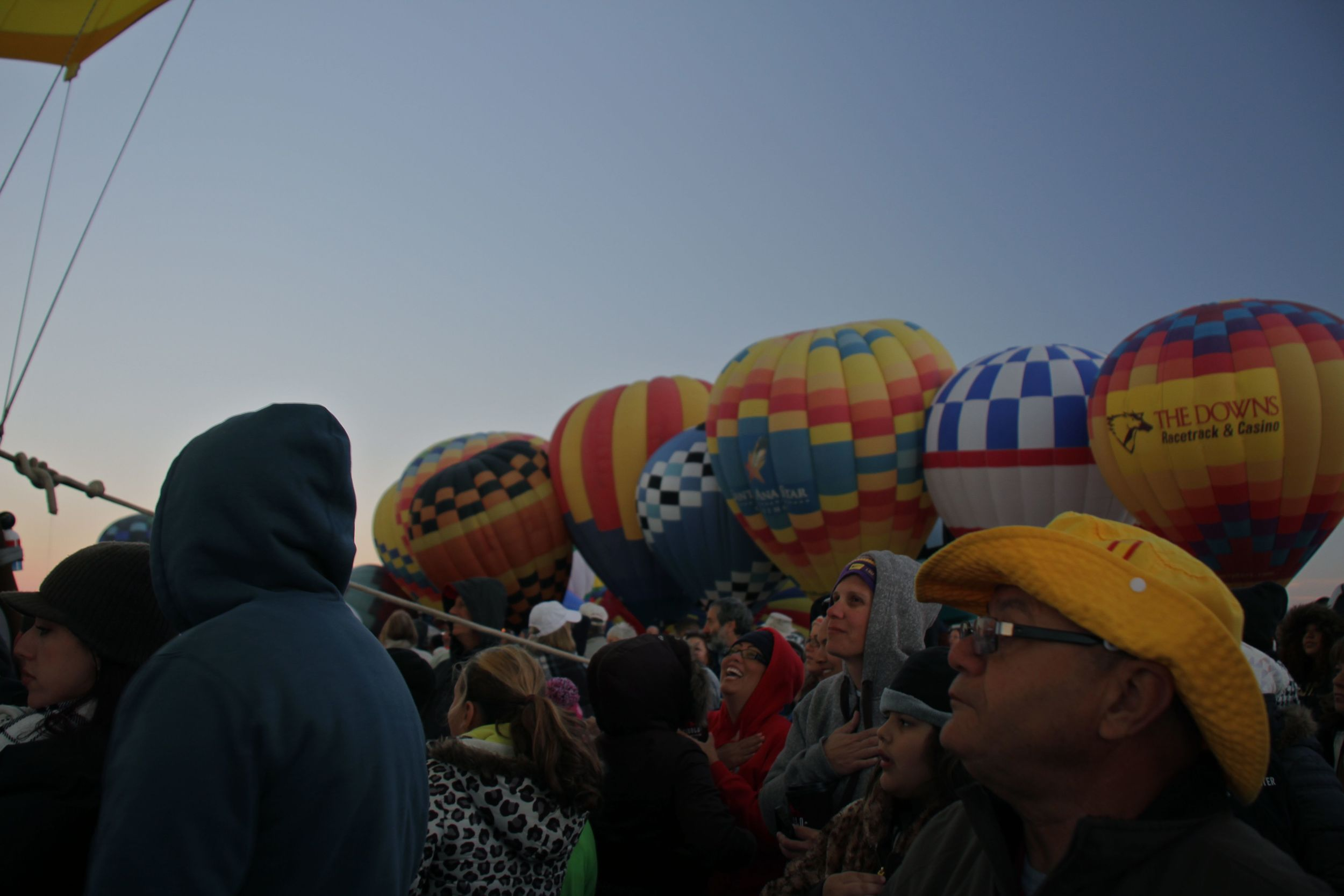 A wall of balloons rises around the crowd