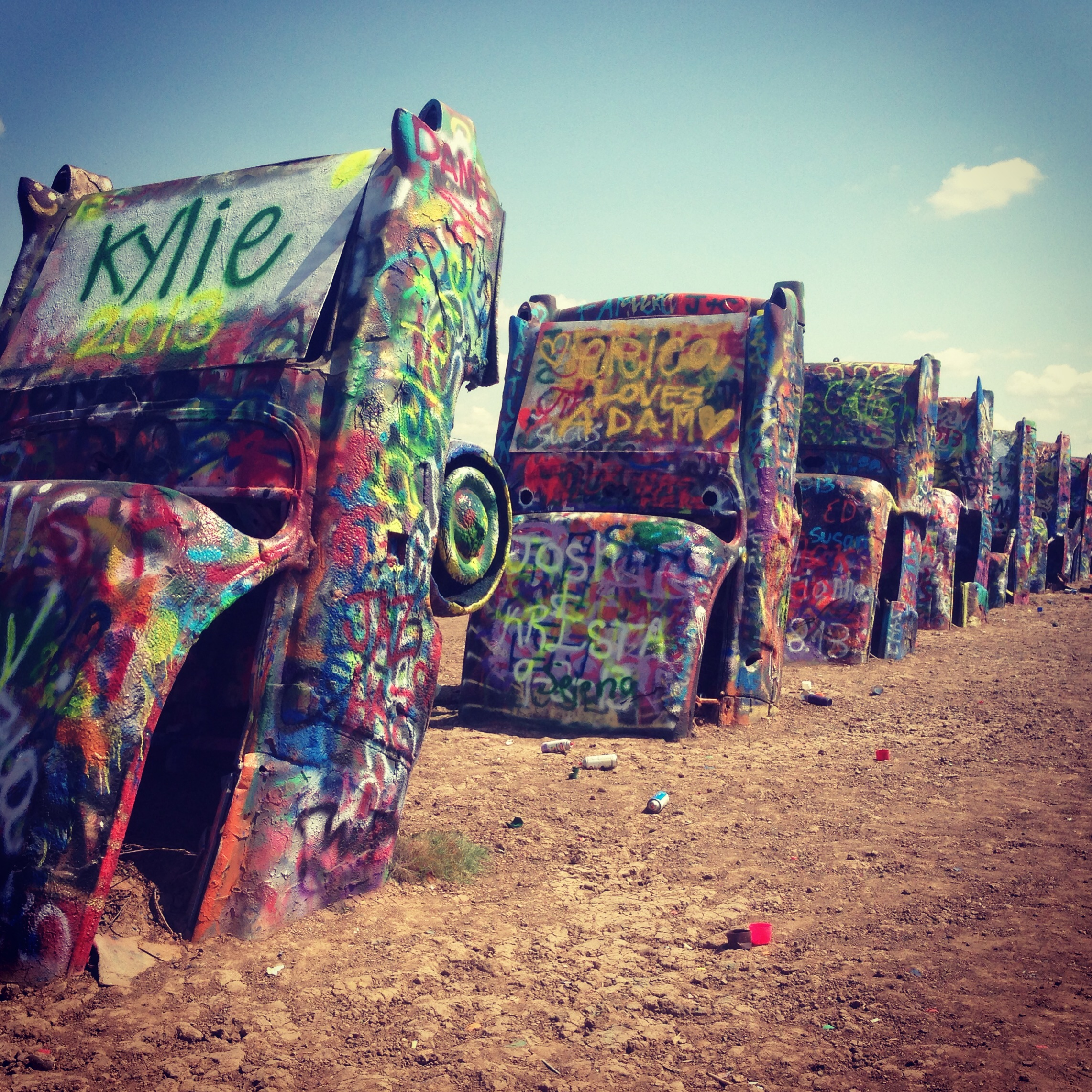 After driving back and forth across the country 5 times, we finally stopped at the Cadillac Ranch in Amarillo, Texas