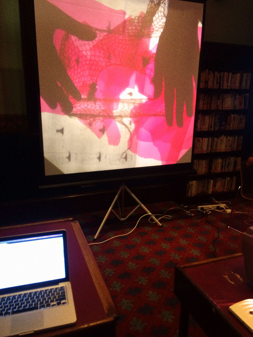 Irit Pollak projecting live collage via overhead projector