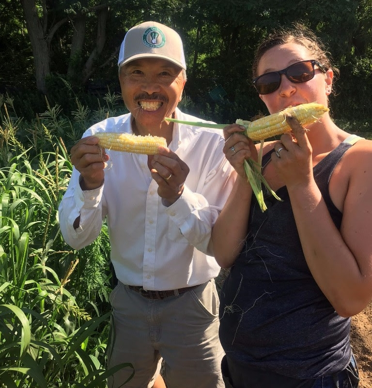 One of our farmers and volunteer taste testing corn in the field... that's fresh!