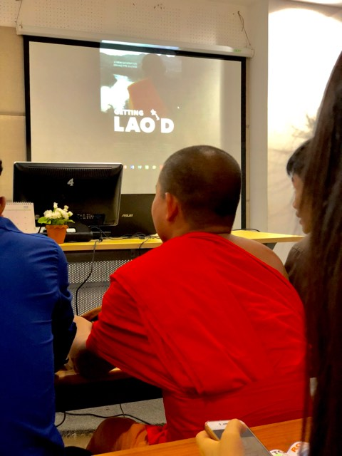 "A student waits to view ""Getting Lao'd"" at a private screening at the National University of Laos in Vientiane."