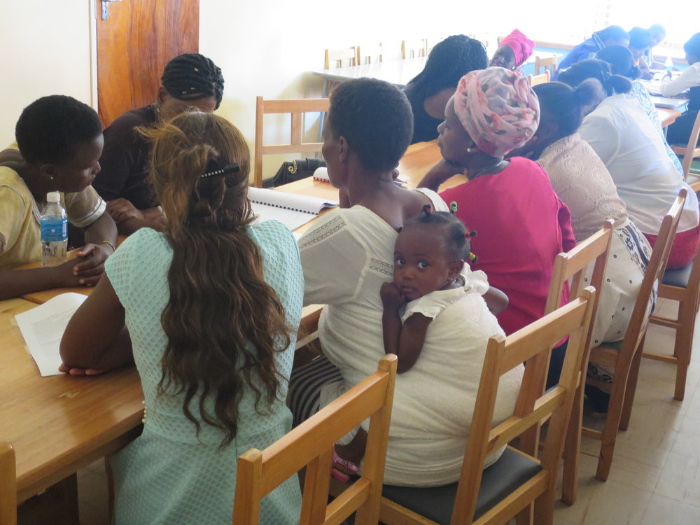 Zim women & baby reading.jpg