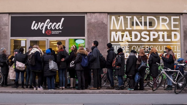 """Thousands line-up outside We-Food's second location at its opening earlier this month. The Danish charity is curbing food waste by selling """"second-hand"""" food, blemishes and all. (We-Food/Facebook)"""