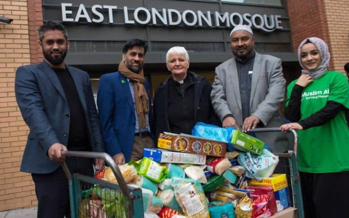 (l-r)Askor Ali, Head Teacher of the London East Academy school, Jehangir Malik, CEO of Muslim Aid, Reverend Bernadette Hegarty of St Pauls, Bow Common Church, Dilowar Khan, Executive Director of the East London Mosque and Muslim Aid volunteer Fatema Mawji     Credit: Muslim Aid/Ben Stevens