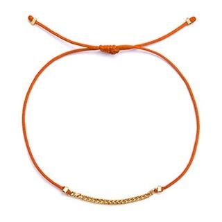 18k gold vermeil mini Cuban link on Orange string bracelet designed for @storm_copenhagen available at the store and online #blackdakini #stormcopenhagen #18kgold #blackdakinibracelet