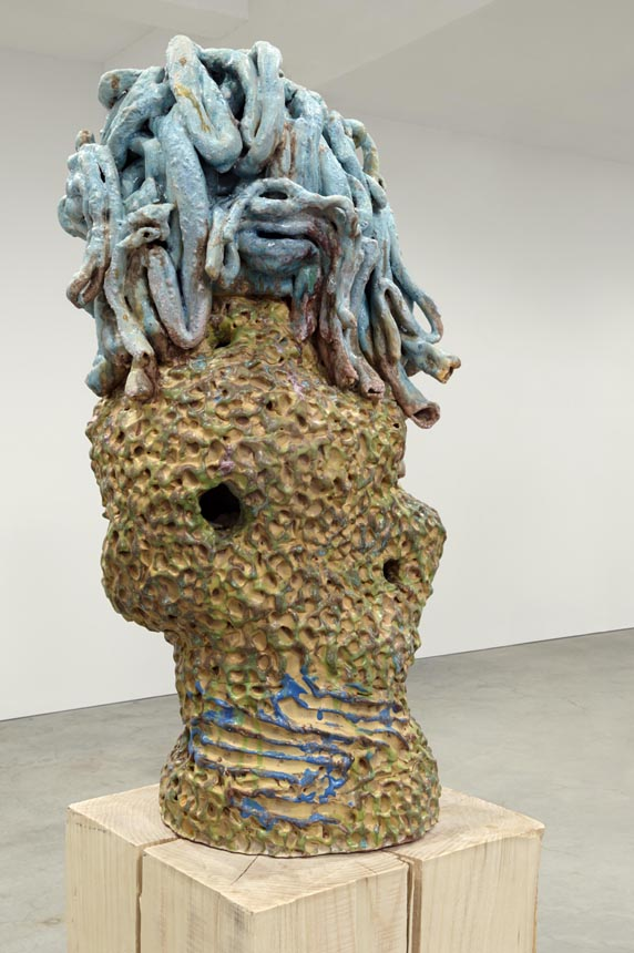 Idle Idol, 2013. Glazed ceramic, wood. 89.5 x 13.5 x 13.5 inches.